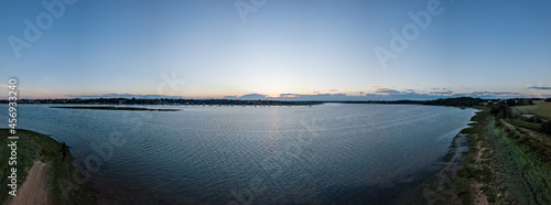 Fotografering Aerial panoramic of a sunset over the River Deben in Suffolk in the UK
