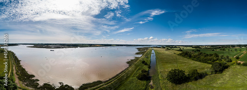 Fotografiet Aerial panoramic of the River Deben in Suffolk, there is a group of people racin