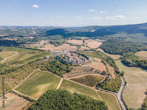 Fototapeta premium Aerial view of Monteriggioni, a beautiful small medieval village on the hill near the vineyard in Val d'Orcia, Tuscany, Italy.