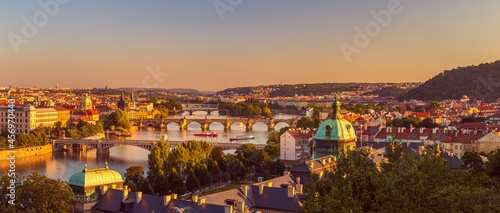 Fotografie, Obraz view of the old city of Prague with the Vltava River, bridges and towers, at sun