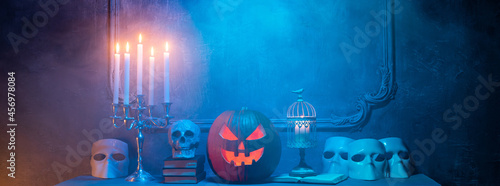 Canvas-taulu Scary laughing pumpkin and old skull on ancient gothic fireplace