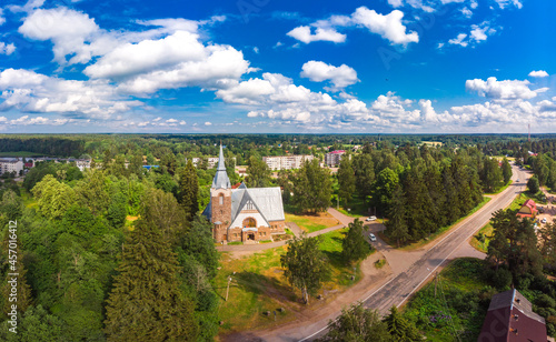 Valokuva Aerial panoramic view to old lutheran church kirk Ryaysyalya designed by architect Joseph Stenback in style of Finnish romanticism, Art Nouveau in sunny summer day