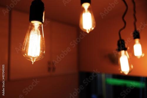 Fotografiet Many retro lighting edison bulbs