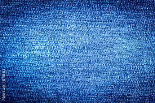 Wallpaper Mural Jeans background denim pattern. Blue denim texture.