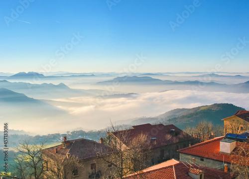 Fotografie, Obraz Evening fog looks good with a birds eye view in San Marino