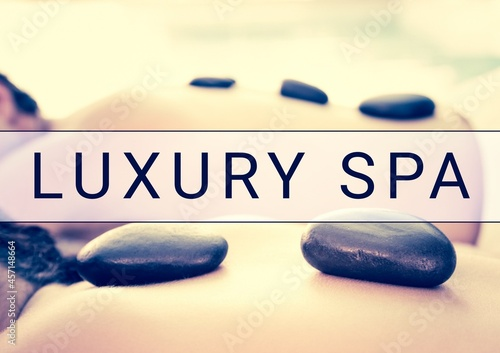 Luxury spa text banner over close up of woman lying for a massage