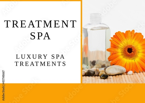 Treatment luxury spa text banner over massage oil, stones and flower against orange background