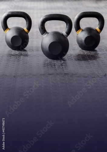 Three kettlebells on the floor at the gym