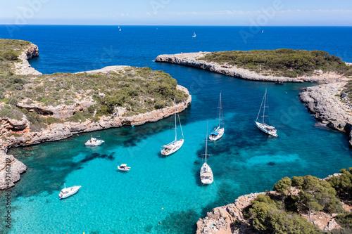 Fotografie, Obraz Aerial view, Cala Sa Nau, near Cala d'Or, with beaches and sailing boats, Migjor