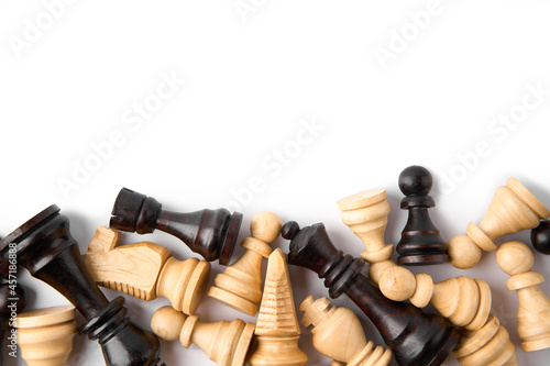 Foto Vintage chess board with checkers, pawns, knights, rooks, bishops, queen and king, black and white colors