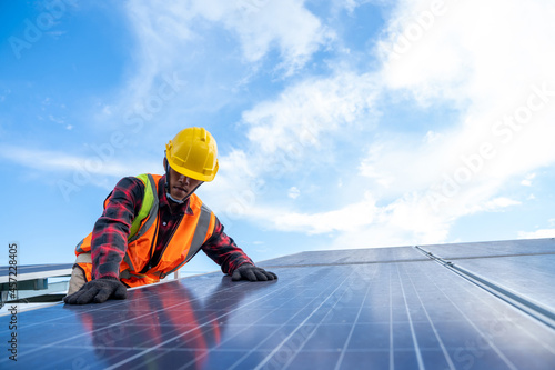 Fototapeta Engineer or electrician working on replacement solar panel at solar power plant,Concept solar power plant to innovation of green energy for life