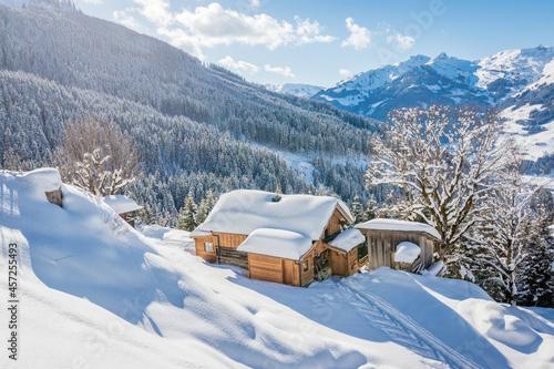 Fotografiet Beautiful winter mountain landscape with snowcapped wooden hut