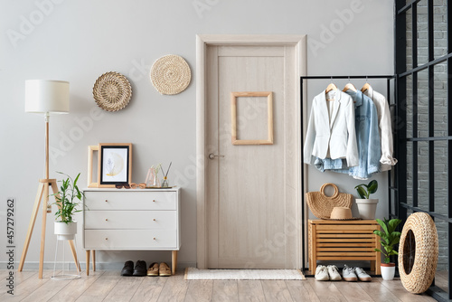 Fotografering Modern interior of stylish hallway with clothes and rug