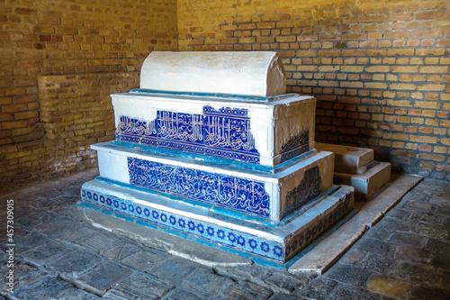Fotografie, Obraz Tiled headstone in medieval mausoleum