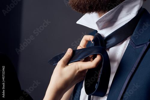 Murais de parede bearded man in suit tying tie elegant style