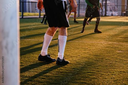 Crop Players On Green Football Field