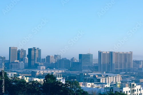 General view of cityscape with multiple modern buildings and skyscrapers in the morning