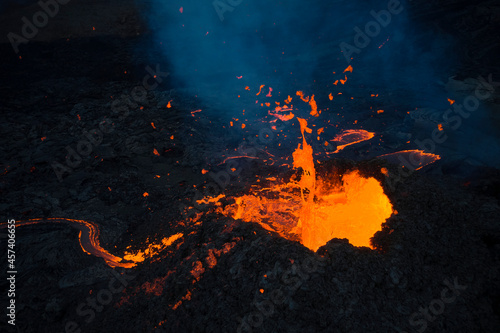 Canvastavla Burning lava flowing from active volcano crater
