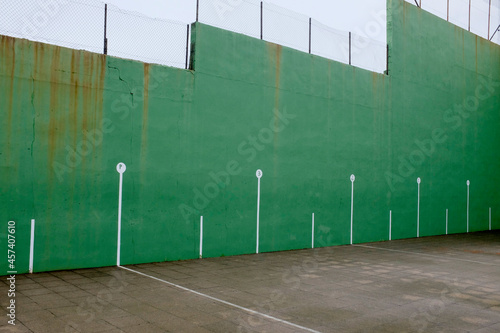 green sports ground with a wall