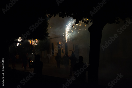 Shadows of men dressed as demons in the festivities of the demons of the Balearic Islands Fotobehang