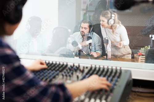 Canvas-taulu Positive presenters in sound broadcasting station hosting live radio show
