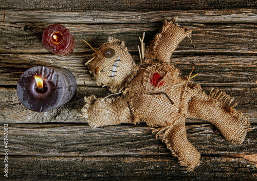 Fotografie, Obraz classic mystical voodoo doll made of burlap for performing an magic ritual on a