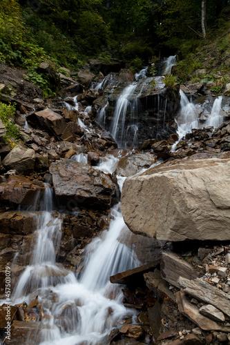 Obraz na plátně River waterfall in a forest landscape