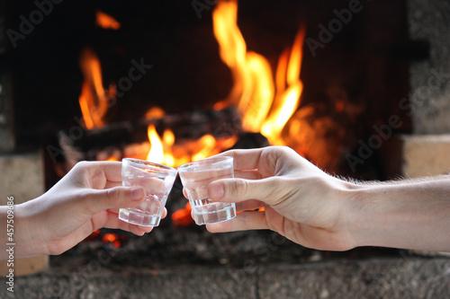 Obraz na plátně closeup of hands with shots of vodk