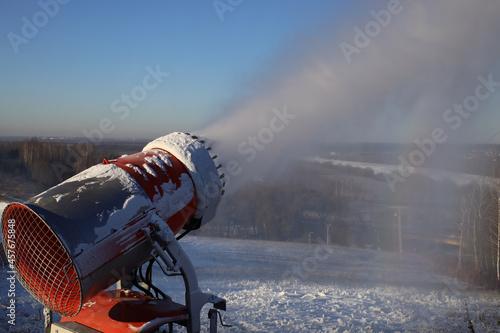 Fototapeta Snow cannon in action at ski resort. Snow Gun at work.