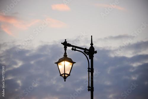 Silhouette of a city lantern against the sky Fototapeta
