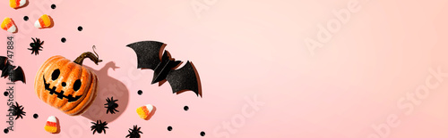 Leinwand Poster Halloween pumpkin ghost with bat and spiders - flat lay