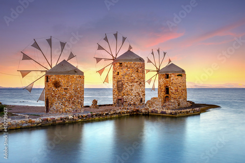 Old windmills by the beach, Chios island, Greece