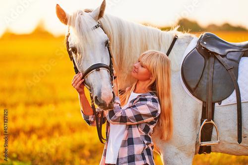 Fotografiet Young cute happy joyful satisfied smiling woman hugging and stroking beautiful w