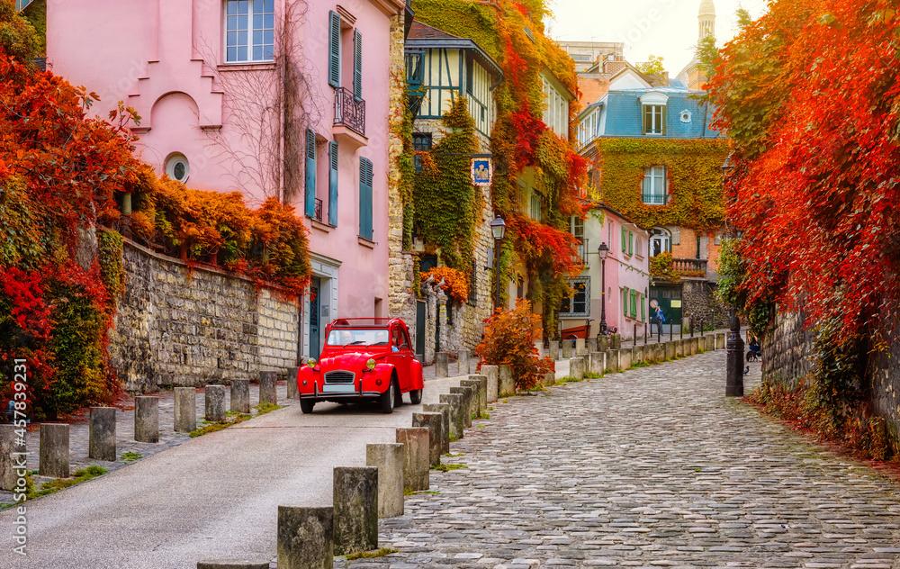 Cozy street in quarter Montmartre in Paris, France. Architecture and landmarks of Paris. Postcard of Paris