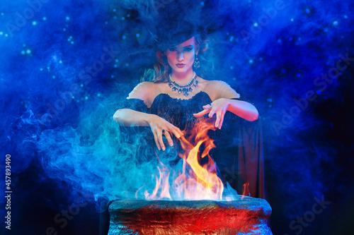 Fotografia conjuring over a cauldron