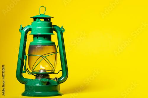 Fotografie, Obraz Stylish retro lamp on color background
