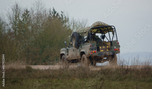 Canvas British army utility medium vehicle Land Rover Defender Wolf in action on a mili