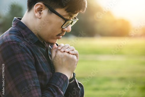 a man hands folded in prayer concept for faith, spirituality, and religion Fototapete