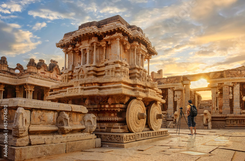 Fotografie, Obraz Stone chariot at Hampi with ancient archaeological ruins in the courtyard of Vit