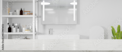 Fotografering White minimalist empty marble tabletop for montage over modern bright bathroom i
