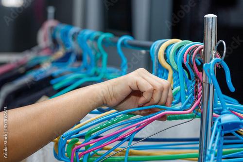 Obraz na plátně Clothes hangers preparing to dry clothes female hand