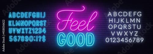 Fotografiet Feel Good neon lettering on brick wall background.