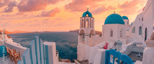 Panoramic summer destination. Traveling concept, sunset scenic famous landscape Santorini island, Oia, Greece. Caldera view, colorful clouds, dream cityscape. Vacation panorama, amazing outdoor scene