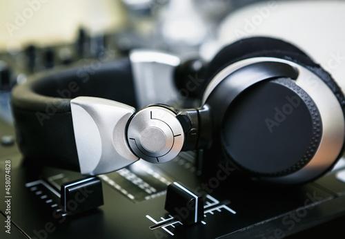 Obraz na płótnie Dj headphones on sound mixer