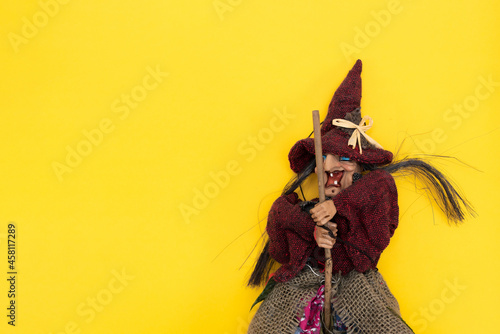 Canvastavla Halloween. Old Baba Yaga on a broomstick on a yellow background