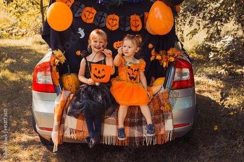 Wallpaper Mural Children celebrating Halloween in trunk of car.