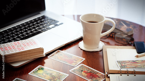 Photo Tarot card reader arranges cards in a card spread