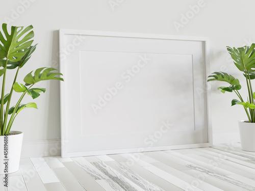 Fototapeta White frame leaning on floor in interior mockup