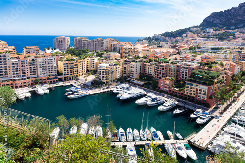 Платно Panoramic aerial view on luxury yachts and apartments of city centre and harbour of Monte Carlo, Cote d'Azur, Monaco, French Riviera