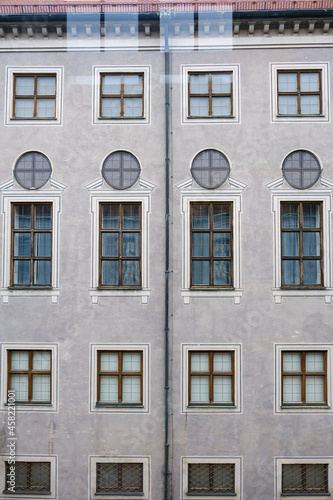 Fotografering Windows inside historic classic old building house palace with archways, columns